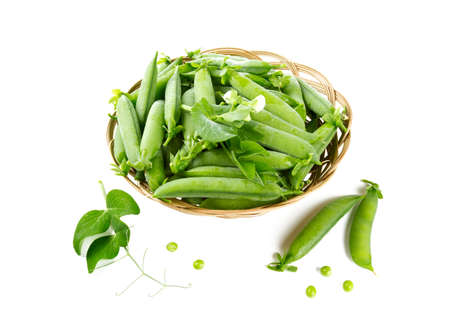 fresh pea pods in a basket isolated on white photo