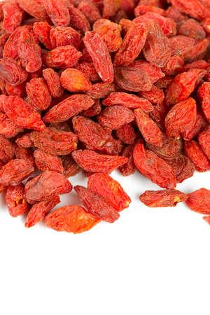 dried goji berries isolated on white photo