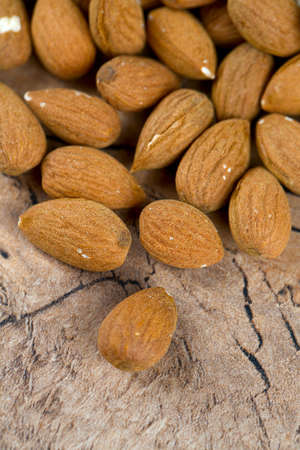 almond nuts on wooden surface photo