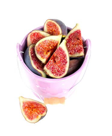 figs in bucket isolated on white photo