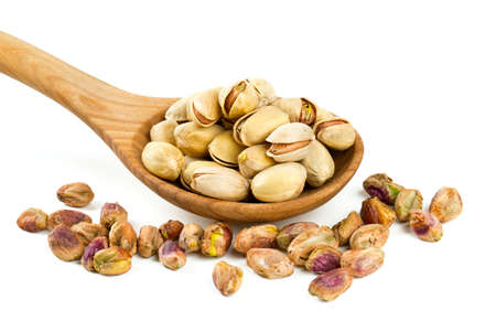 pistachio in scoop isolated on white photo