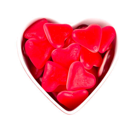 heart-shaped candies isolated on white photo