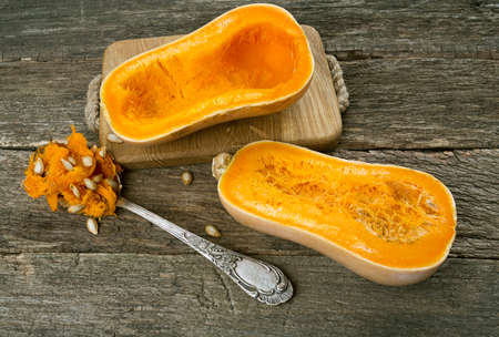 butternut squash over old wood background
