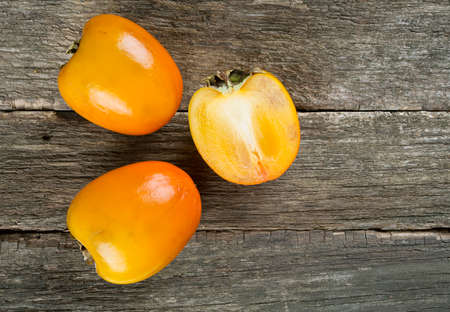 tannins: persimmons on wooden surface
