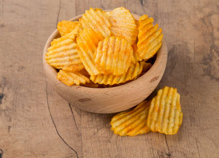 flatfoot: potato chips in a wooden bowl