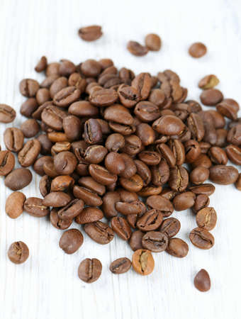 coffeetree: coffee beans on wooden surface Stock Photo