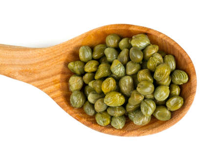 capers isolated on white Фото со стока
