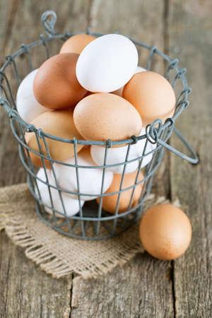 fresh farm eggs in iron basket photo