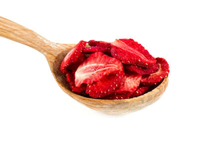 dehydrated: Dehydrated sliced strawberries in a wooden spoon