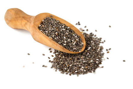scoops: chia seeds in a wooden scoop isolated on white