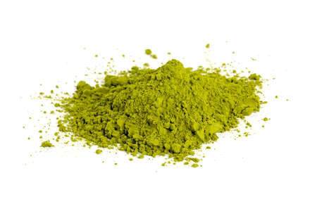 green drink powder: pile of Matcha tea isolated on white