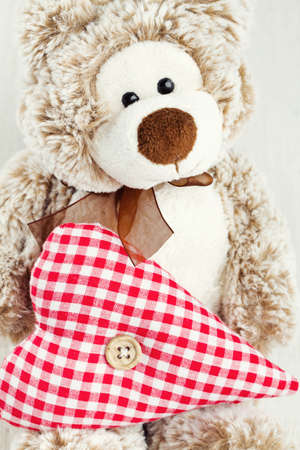 valentine s day teddy bear: teddy bear holding heart Stock Photo
