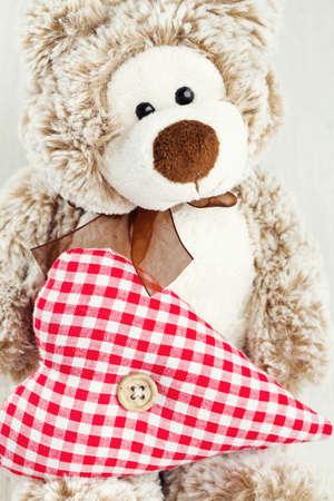 teddy bear holding heart photo