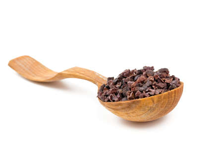 cocoa nibs in a wooden spoon photo