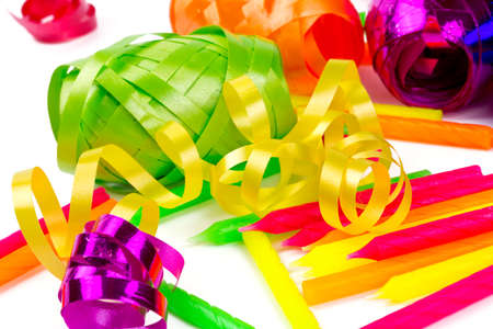 coloful ribbons and cake candles isolated on white photo