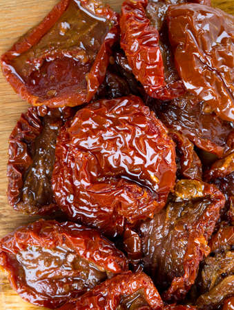 sun dried: sun dried tomatoes with olive oil on wooden surface