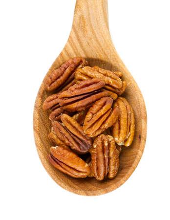 un healthy: pecan nuts in a wooden spoon Stock Photo