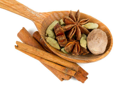 anice: nutmeg, cinnamon, cardamom and star anise isolated on white Stock Photo