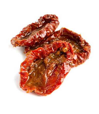 sun dried: sun dried tomatoes with olive oil isolated on white