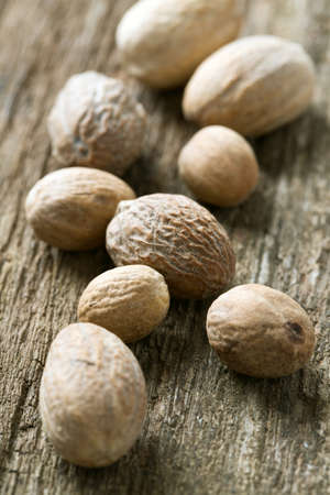 nutmeg: nutmeg on wooden surface