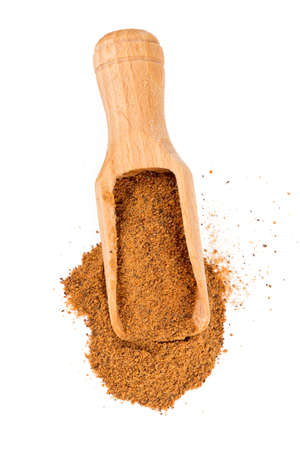 wooden spoon: ground nutmeg in a scoop Stock Photo