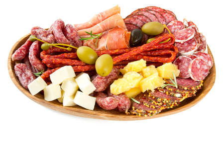 Antipasti and catering platter with different meat and cheese products
