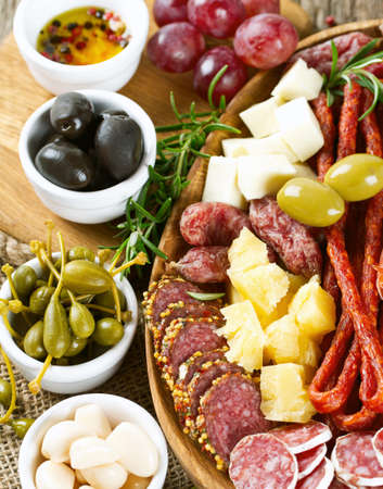 lunch tray: Antipasti and catering platter with different meat and cheese products