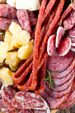 smoked salami, sausages, proschiutto and cheese photo