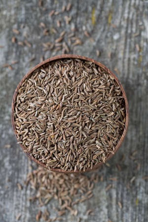 cumin: dried cumin on wooden surface