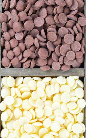 milk and white chocolate chips in a wooden  box Stock Photo