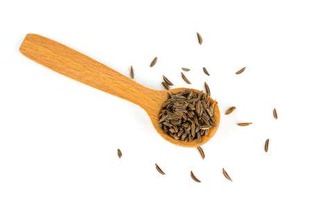 cumin: dried cumin in a wooden spoon