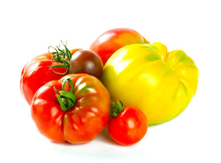 assorted tomatoes isolated on white