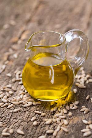 sunflower oil: sunflower seed oil on wooden surface