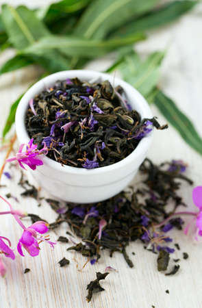 compacted: fireweed tea on wooden surface