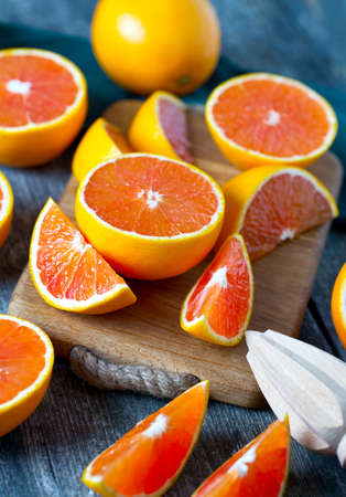 of orange: red oranges on wooden surface Stock Photo