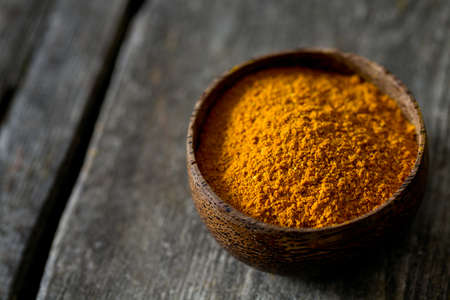 curry powder: curry powder on wooden surface