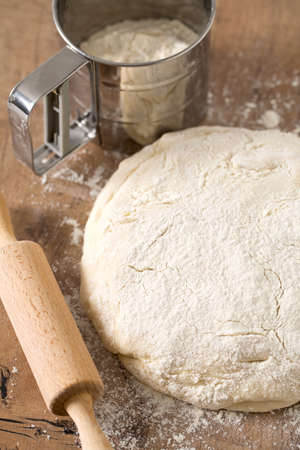 freshly prepared: wooden rolling pin with freshly prepared dough
