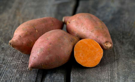 yam: sweet poato on wooden surface