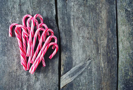christmas candies: Striped Christmas candies on wooden surface