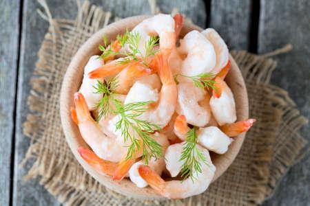 frozen food: frozen shrimps on wooden surface