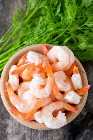 frozen shrimps on wooden surface