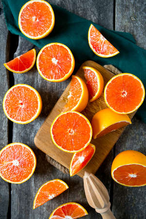 cut fruit: red oranges on wooden surface Stock Photo