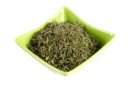 thymine: dried thyme in a bowl over white