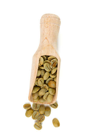 wooden scoop: green coffee beans in a wooden scoop Stock Photo