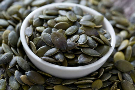 pumpkinseed: pumpkin seeds on wooden surface