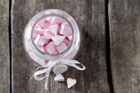 heartshaped: heart-shaped marshmallows on wooden surface Stock Photo