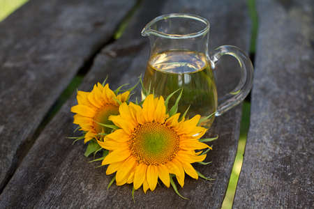 sunflower seeds: sunflower oil on garden table Stock Photo