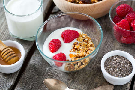 snack: healthy snack - granola on wooden surface