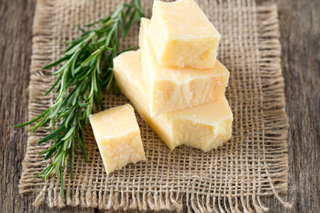 chees: parmesan chees on wooden surface Stock Photo