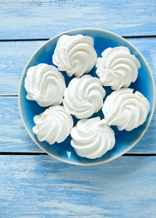 kiss biscuits: beautiful mirengue on wooden surface